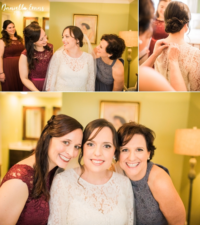Bride getting ready for wedding with mom and sister