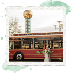 Bride and Groom with trolley and knoxville sunsphere in background